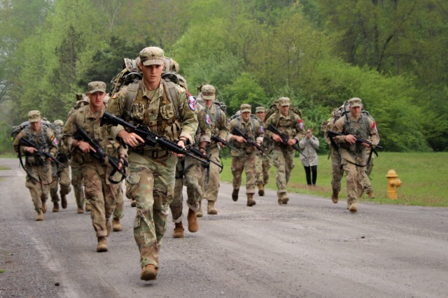 Sgt. Jordy Brewer with the 1st Battalion, 149th Infantry leads the pack in the ruck march event during the National Guard Region III Best Warrior Competition in Tullahoma, Tenn., April 26, 2018. Brewer, Kentucky's NCO of the Year, would go on to win the Region III and national titles, sending him to the All-Army Best Warrior in September.