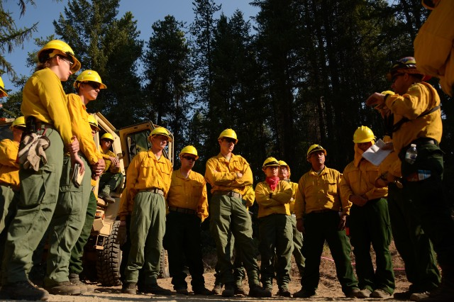 Washington Army National Guard Soldiers conduct a safety brief prior to firefighting operations on the Sheep Creek fire Aug. 5, 2018, near Northport, Wash.
