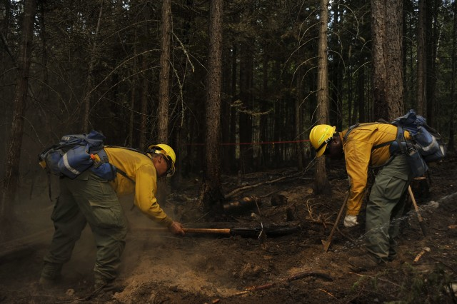 Washington Army National Guard Soldiers clear hot spots along the fire line of the Sheep Creek fire Aug. 5, 2018, near Northport, Wash. Soldiers and Airmen from the Washington National Guard make up 41% of all hand crews on scene fighting the Sheep Creek fire.