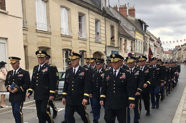 "42nd Infantry Division Soldiers march to a ceremony commemorating the 100th anniversary of the 167th Regiment (Alabama National Guard) of the 42nd ""Rainbow"" Division fight at the Croix Rouge Farm in Fère-en-Tardenois, France on July 29, 2018."