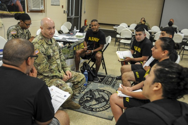 Sgt. 1st Class Brain Kleman, a career counselor with Army Reserves Careers Division, speaks with Soldiers who are a part of the Fit for Life (F2L) program, Aug. 4. F2L is an Army reserve pilot program designed to help Soldiers who are not eligible to re-enlist due to not meeting the Army height and weight program or physical fitness standards. The program not only assist Soldiers in improving their physical fitness, nutrition and resiliency, but also enhances Army Reserve readiness and retention.
