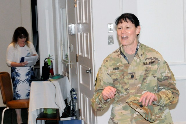 Lt. Col. Karen Luisi, First Army Commander's Ready and Resilient Council C manager, addresses attendees during the First Army SHARP summit at the Rock Island Arsenal Golf Clubhouse on Rock Island Arsenal, Ill., on Aug. 7.