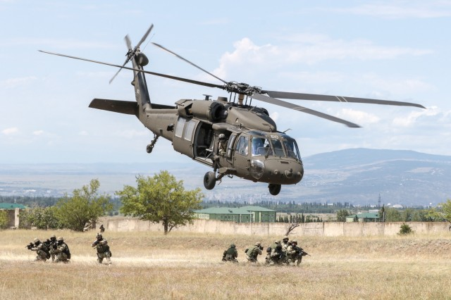 A Georgia Army National Guard UH-60 Black Hawk from the Marietta based, 1st Battalion, 171st Aviation Regiment, lifts off rapidly after inserting Georgian special forces during an urban operations exercise at the Vaziani Training Area on Aug 5, 2018 during Noble Partner 18. The exercise highlights the 24 years the two militaries have worked together under the U.S. National Guard State Partnership Program.