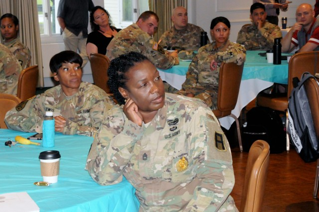 First Army SARC and Victim Advocates listen to opening remarks during the First Army SHARP summit at the Rock Island Arsenal Golf Clubhouse on Rock Island Arsenal, Ill., on Aug. 7.