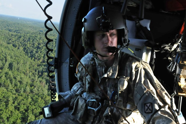 A Soldier with Detachment 1, Charlie Company, 2nd Battalion, 238th Aviation prepares for a hoist lift rescue during a training exercise near Campton, Ky., Aug. 3, 2018.