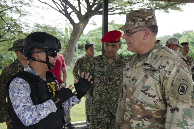 U.S. Army Col. Anthony Lieggi, 96th Troop Command, Washington Army National Guard, and Royal Malaysian Navy Lieutenant Mohd Khairul Hafiz, a Clearance Diver, with Unit 3, Explosive Ordinance Disposal, discuss proper improvised explosive device procedures during Exercise Keris Strike 2018, Camp Senawang, Malaysia, July 26, 2018. Malaysian and U.S. Army subject matter experts have been working together to improve the technical expertise of both countries' soldiers.
