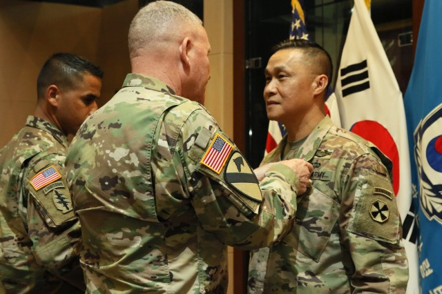 Maj. Gen. Viet X. Luong, Eighth Army deputy commanding general for operations, is awarded the Legion of Merit by Lt. Gen. Michael A. Bills, Eighth Army commanding general, for his service and dedication to Eighth Army as a deputy commander at Eighth Army Headquarters, U.S. Army Garrison Humphreys, Aug. 8. Luong will soon take over as the new incoming commanding general for U.S. Army Japan (USARJ) after the dedication that he and his wife gave to Eighth Army since July 2017.