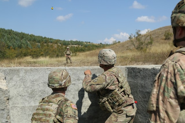 KRIVOLAK TRAINING AREA, Republic of Macedonia - Cavalry Scouts with the 3rd Squadron, 61st Cavalry Regiment, 1st Brigade, 4th Infantry Division, practice throwing hand grenades at the Krivolak Training Area in the Republic of Macedonia, August 1. (US Army photo by Spc Jarel Chugg, 19th Public Affairs Detachment)