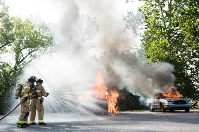 Fort Knox firefighters attempt to extinguish a car fire during the installation-wide emergency preparedness exercise conducted last week from July 31 to Friday. Several organizations participated in the biennial event.