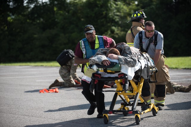 Members of emergency services rush a patient from the scene of the mass casualty event.