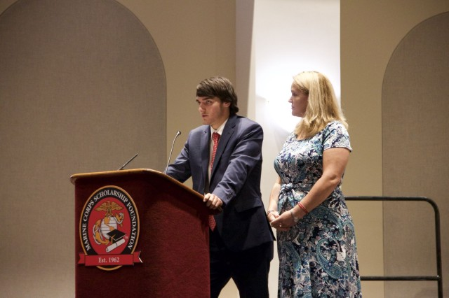 Christian and Heather Golczynski share their stories about how they've been impacted by the Marine Corps and the scholarship foundation during the Marine Corps Scholarship Foundation announcement ceremony Aug. 1 at the Marine Barracks in Washington, D.C.