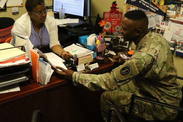 Spc. Mike Berry discusses his education goals with Jeannette Sydnor-Thickening, lead education services specialist and HUB deputy director JBM-HH Education Center Aug. 2.