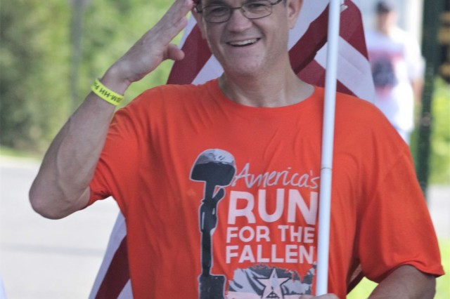An America's Run for the Fallen participant salutes near Brucker Hall during the final day of the coast-to-coast run which finished Sunday on Joint Base Myer-Henderson Hall and Arlington National Cemetery. The run traveled through 19 states starting in California and concluding in Virginia.