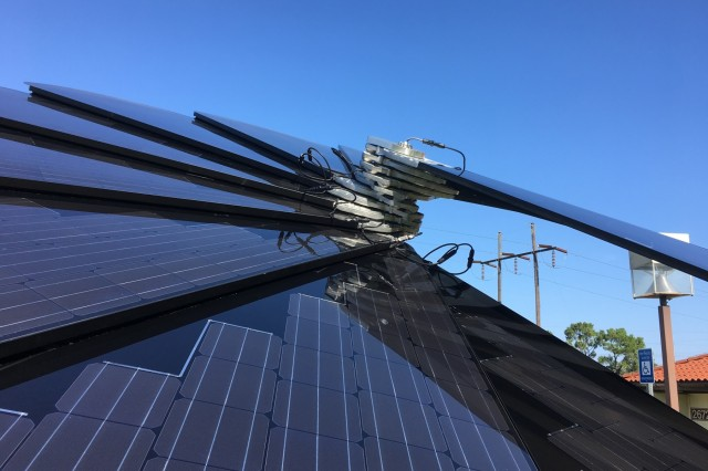"FORT BENNING, Ga. (Aug. 9, 2018) - The Directorate of Public Works recently installed a ""Smartflower"" at their Environmental Learning Center just south of the Benning Road gate at Fort Benning, Georgia. The 2.3-kilowatt solar array converts sunlight into direct current electricity via photovoltaic cells and maintains effective collection by tracking the sun throughout the day and brushing itself clear of dust when it folds up at night. (U.S. Army photo by Bryan Gatchell, Maneuver Center of Excellence, Fort Benning Public Affairs)"