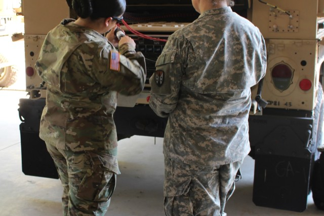 Sgt. Keila Peters, left, assigned to the U.S. Army Communications-Electronics Center, and Staff Sgt. Evelien Josselin, U.S. Army Sustainment Command-Army Reserve Element Detachment 7, demonstrate the ease in loading and unloading server stacks onto the Command Post Platform (Improved), which provides mobile support for command and control equipment in a reduced footprint over previous solutions.