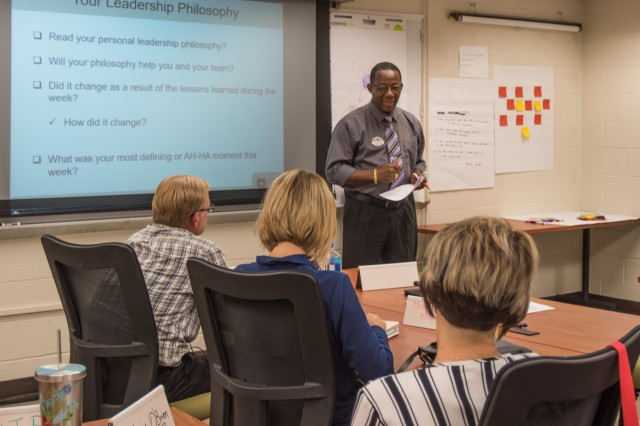 Norris Johnson, Supervisory Education Services specialist, presents his leadership philosophy to his fellow classmates Friday during the Supervisory Leadership Course.