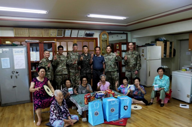 POCHEON, Republic of Korea - Soldiers of 2nd Infantry Division/ROK-U.S. Combined Division and the senior residents of Kyeong-ro-dang (the senior community center) take a group photo during the division Civil Affair's-led visit to the center as part of the U.S. Forces Korea Good Neighbor Program August 8. The Good Neighbor Program aims to promote friendship, trust, and mutual understanding between USFK service members and the Republic of Korea citizens through volunteer service and activities. (U.S. Army photo by KATUSA Pfc. Seung Ho Park, 2ID/RUCD Public Affairs)