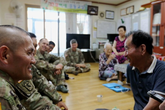POCHEON, Republic of Korea - 2nd Infantry Division/ROK-U.S. Combined Division Chaplain Lt. Col. Hyeonjoong Kim speaks with the chairperson of the Kyeong-ro-dang (the senior community center), Mr. Sung Chan Park, about his childhood Korean War experience during the division Civil Affair's-led visit to the center as part of the U.S. Forces Korea Good Neighbor Program August 8. The Good Neighbor Program aims to promote friendship, trust, and mutual understanding between USFK service members and the Republic of Korea citizens through volunteer service and activities. (U.S. Army photo by KATUSA Pfc. Seung Ho Park, 2ID/RUCD Public Affairs)