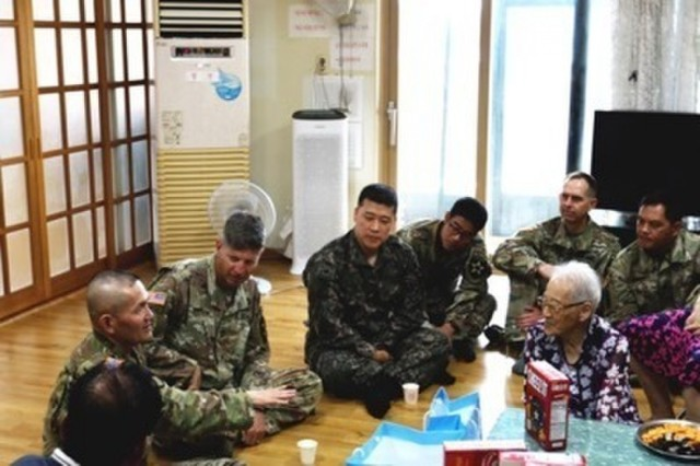 POCHEON, Republic of Korea -Lt. Col. Hyeonjoong Kim, 2nd Infantry Division/ROK-U.S. Combined Division Chaplain discusses the purpose of the visit with the elderly members of the Kyeong-ro-dang (the senior community center) during the division Civil Affair's-led visit to the center as a part of the U.S. Forces Korea Good Neighbor Program August 8. The Good Neighbor Program aims to promote friendship, trust, and mutual understanding between USFK service members and the Republic of Korea citizens through volunteer service and activities. (U.S. Army photo by KATUSA Pfc. Seung Ho Park, 2ID/RUCD Public Affairs)