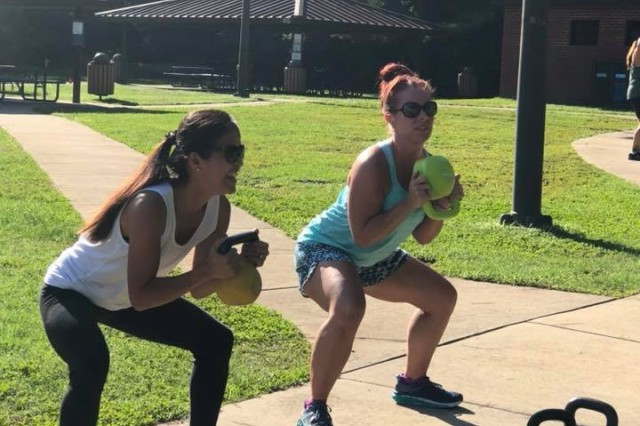 Two spouses of paratroopers assigned to the 5th Squadron, 73rd Cavalry Regiment, 3rd Brigade Combat Team, 82nd Airborne Division perform kettlebell squats during the inaugural Airborne Thunder at Pope Army Airfield's Woodland Park on Aug. 8, 2018. The event was designed to build relationships within the Squadron's Family Readiness Group and inform spouses of upcoming training events.