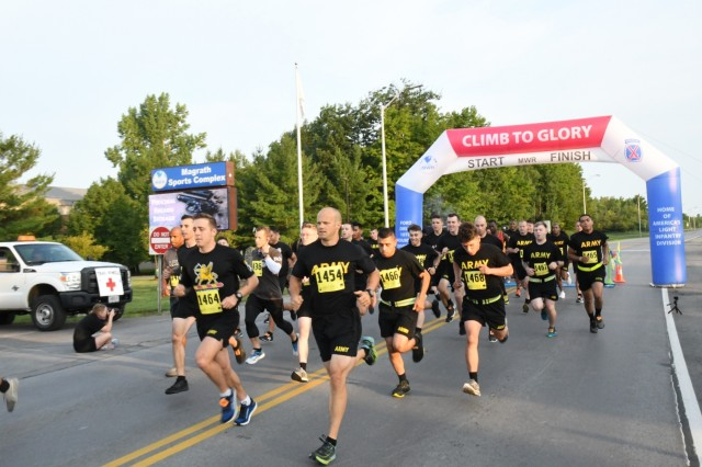 More than 45 members of the 10th Mountain Division gathered outside Magrath Sports Complex on Aug. 8 to try out for the Fort Drum Army Ten-Miler Team. This was the second qualifier before the 18 runners are selected for the men's, women's and active-duty mixed teams. (U.S. Army Photo by Mike Strasser, Fort Drum Garrison Public Affairs)
