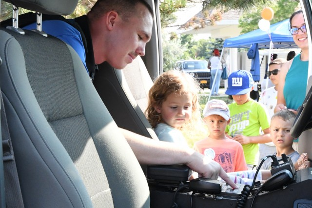 Hundreds of Fort Drum residents gathered outside Adirondack Creek Community Center on Aug. 7 for the annual National Night Out event, hosted by Fort Drum Mountain Community Homes. (U.S. Army Photo by Mike Strasser, Fort Drum Garrison Public Affairs)