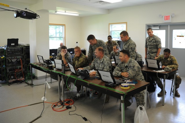 Airmen and Soldiers gather during Exercise Patriot Warrior for cyber defense training on Aug. 8, 2018 at Fort McCoy, Wisc. Patriot Warrior is Air Force Reserve Command's premier exercise, providing an opportunity for Reserve Citizen Airmen to train with joint partners in the combat support training exercise.