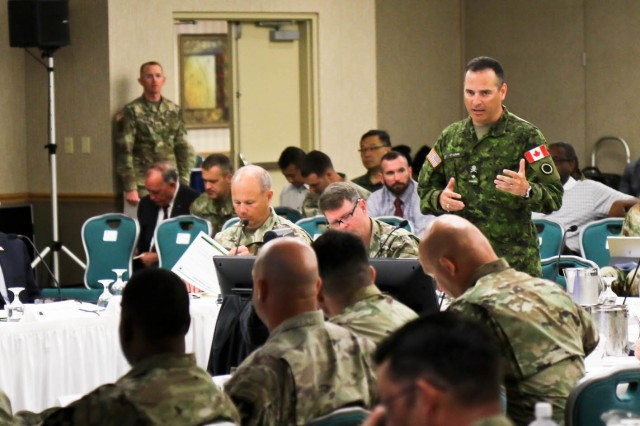 Canadian Army Brig. Gen. Michel-Henri St-Louis, the Deputy Commanding General for Operations for I Corps, introduces himself to the Stryker Warfighter Forum Leader's Summit attendees August 1, 2018 on Joint Base Lewis-McChord. The two-day summit brings together senior leaders, Department of the Army civilians and industry experts to discuss the modernization of the Stryker and how it fits into the Army's readiness to deploy fight and win on tomorrow's battlefield.
