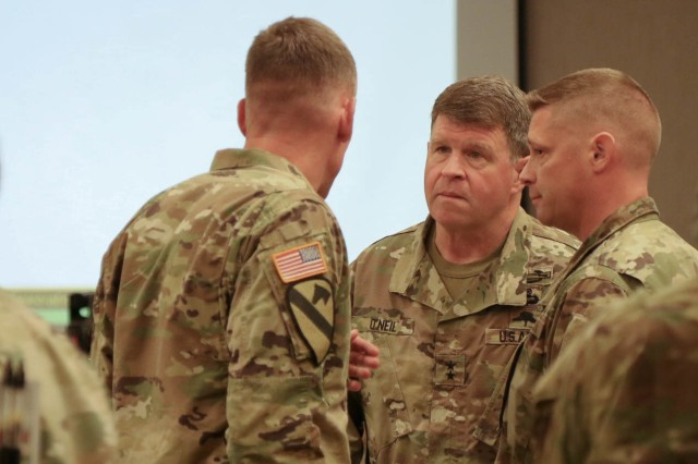 Maj. Gen. Mark O'Neil (center), commander of U.S. Army Alaska, converses with I Corps commanding general, Lt. Gen. Gary Volesky (left), at the Stryker Warfighter Forum Leader's Summit August 1, 2018 on Joint Base Lewis-McChord. The two-day summit brings together senior leaders, Department of the Army civilians and industry experts to discuss the modernization of the Stryker and how it fits into the Army's readiness to deploy, fight and win on tomorrow's battlefield