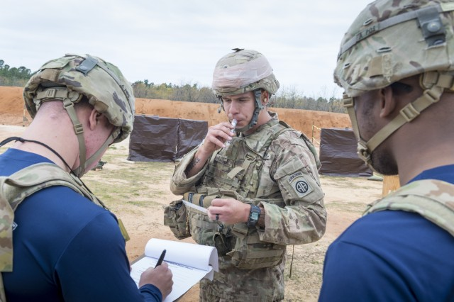 A Soldier with the 82nd Airborne Division spits into a test tube that researchers from the U.S. Army Research, Development and Engineering Command Soldier Center tested for cortisol levels during a stress shoot test.