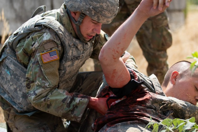 Sgt. Samuel Arnold, 520th Medical Company, performs tactical combat casualty care during the 2018 Pacific Best Medic Competition, hosted by Regional Health Command-Pacific Aug. 7-10, 2018 at Joint Base Lewis-McChord, Wash.
