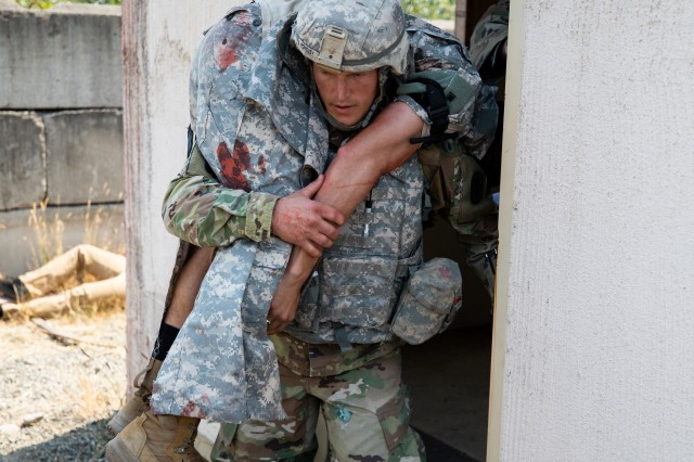 Sgt. 1st Class Adam Pohovey, Madigan Army Medical Center, carries a mock casualty during a combat scenario as part of the 2018 Pacific Best Medic Competition hosted by Regional Health Command-Pacific Aug. 7-10, 2018 at Joint Base Lewis-McChord, Wash.