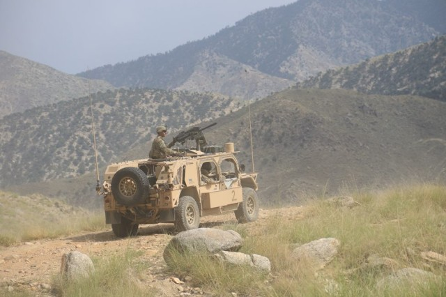 A Soldier from Aztec Company, 2nd Battalion, 23rd Infantry Regiment, 1st Stryker Brigade Combat Team, 4th Infantry Division, keeps watch from the gunner's position of a Ground Mobility Vehicle in eastern Afghanistan, July 28, 2018