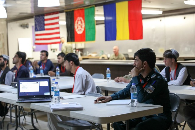 KANDAHAR AIRFIELD, Afghanistan (July 14, 2018) -- Officers from the Afghan National Police listen to instructions, July 14, 2018, during an interview and reporting course for the ANP in Kandahar Airfield, Afghanistan. The course is taught by members of the Police Advisory Team for Train, Advise and Assist Command-South to help enable the Afghan National Defense and Security combat capabilities. (U.S. Army photo by Staff Sgt. Neysa Canfield)