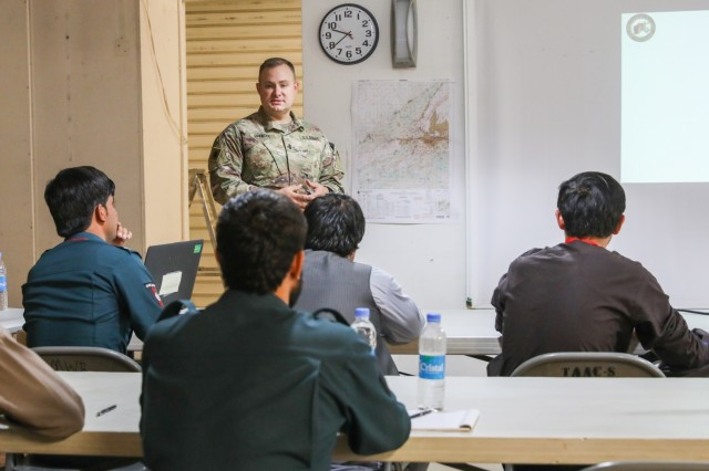 KANDAHAR AIRFIELD, Afghanistan (July 17, 2018) -- 1st Lt. Daniel D. Spencer, legal advisor assigned to the Police and Military Advisory Team for Train, Advise and Assist Command-South, talks about civil rights to the officers of the Afghan National Police, July 17, 2018,  during an Interview and Reporting course for the ANP in Kandahar Airfield, Afghanistan. The course is taught by members of the Police Advisory Team for Train, Advise and Assist Command-South to help enable the Afghan National Defense and Security Force combat capabilities. (U.S. Army photo by Staff Sgt. Neysa Canfield)