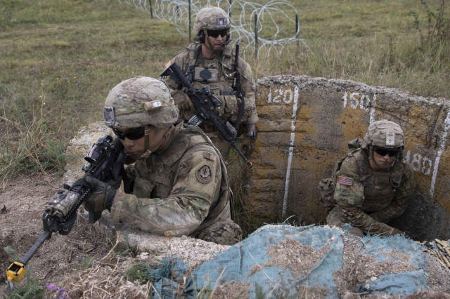 Spc. Nikko Laurel, Staff Sgt. Jasun Cunha, and Pfc. Eric James of Iron Troop, 3rd Squadron, 2nd Cavalry Regiment establish a secure firing position during an air assault exercise Aug. 9, 2018 during Noble Partner 18 at Camp Norio Training Area, Georgia.