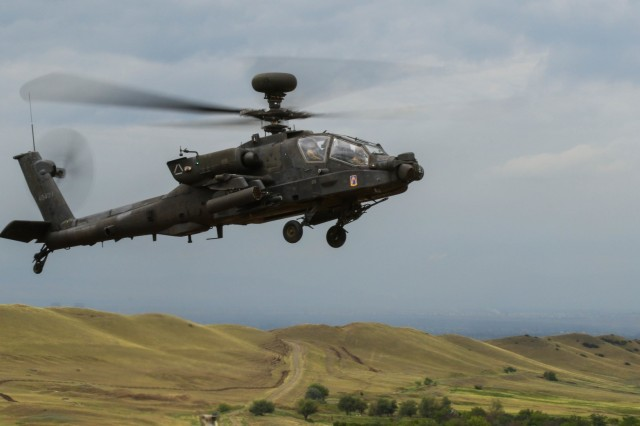 An AH-64 Apache helicopter with 1st Battalion, 3rd Aviation Regiment hovers above Vaziani Training Area, Georgia, during a combined arms live fire exercise led by 2nd Battalion, 5th Cavalry Regiment, Aug. 12, 2018. 2-5 CAV participated in Noble Partner 2018, a Georgian Armed Forces and U.S. Army Europe cooperatively-led exercise in its fourth iteration intended to support and enhance the readiness and interoperability of Georgia, the U.S. and participating nations during a multinational training operation. (U.S. Army photo by Sgt. Kris Bonet)