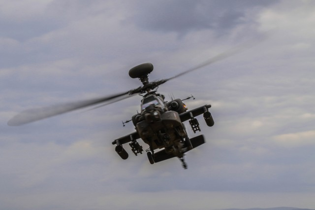An AH-64 Apache helicopter with 1st Battalion, 3rd Aviation Regiment maneuvers above Vaziani Training Area, Georgia, during a combined arms live fire exercise led by 2nd Battalion, 5th Cavalry Regiment, Aug. 12, 2018. 2-5 CAV participated in Noble Partner 2018, a Georgian Armed Forces and U.S. Army Europe cooperatively-led exercise in its fourth iteration intended to support and enhance the readiness and interoperability of Georgia, the U.S. and participating nations during a multinational training operation. (U.S. Army photo by Sgt. Kris Bonet)