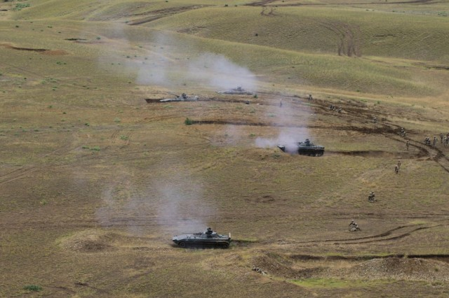 A platoon of Georgian army BMP-2 infantry fighting vehicles with the 4th Mechanized Brigade shoots pop-up targets during a combined arms live fire exercise led by 2nd Battalion, 5th Cavalry Regiment, at Vaziani Training Area, Georgia, Aug. 12, 2018. The exercise was part of Noble Partner 18, a cooperatively-led exercise intended to support and enhance the readiness and interoperability of Georgia and other participating nations. (U.S. Army photo by Sgt. Kris Bonet)