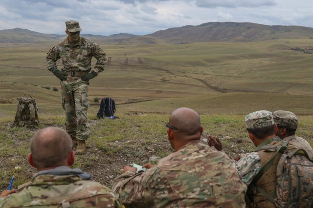Col. Thomas M. Hough, commander of the 2nd Cavalry Regiment, offers his input during an after action review for a recently conducted combined arms liver fire exercise led by Soldiers with 2nd Battalion, 5th Cavalry Regiment at Vaziani Training Area, Georgia, Aug. 12, 2018. The exercise was part of Noble Partner 18, a cooperatively-led exercise intended to support and enhance the readiness and interoperability of Georgia and other participating nations. (U.S. Army photo by Sgt. Kris Bonet)