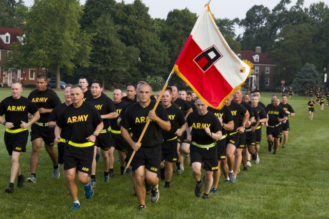 4th Cavalry Multi-Functional Training Brigade Commander, Col. James Turner (front left), and 1st Brigade Engineer Battalion, 410th Regiment observer coach/trainer, Sgt. 1st Class William Waddell (front right), lead a column of First Army Soldiers across Brooks Field on Aug. 13, concluding a three-mile run. The run included every unit on Fort Knox, Ky., and kicked off the post's Centennial Week celebration. (U.S. Army photo by Sgt. 1st Class Gary J. Cooper)