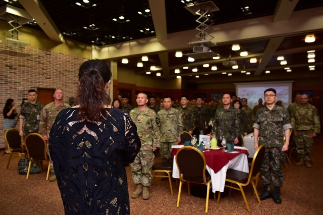 CAMP RED CLOUD, Republic of Korea -- Ms. Song Ok Namgung, contemporary Christian music jazz artist, sings the Korean and American national anthems during the 2018 Victory Prayer Luncheon at Mitchell's Grill Aug. 13. The 2nd Infantry Division/ROK-U.S. Combined Division Unit Ministry Team hosted the event in observance of Korean Liberation Day and Victory in the Pacific Day.
