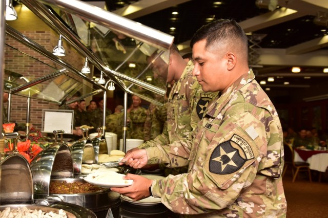 CAMP RED CLOUD, Republic of Korea -- Soldiers from 2nd Infantry Division/ROK-U.S. Combined Division enjoy the selection of Mexican food provided at the 2018 Victory Prayer Luncheon at Mitchell's Grill August 13. The 2ID/RUCD Unit Ministry Team hosted the event in observance of Korean Liberation Day and Victory in the Pacific Day.