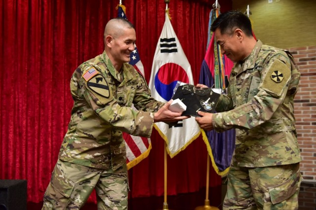 CAMP RED CLOUD, Republic of Korea -- Chaplain (Lt. Col.) Hyeonjoong Kim, 2ID/RUCD command chaplain presents guest speaker Chaplain (Col.) Chul W. Kim, Eighth Army command chaplain a token of appreciation on behalf of the 2nd Infantry Division/ROK-U.S. Combined Division Unit Ministry Team during the 2018 Victory Prayer Luncheon at Mitchell's Grill August 13. The 2ID/RUCD Unit Ministry Team hosted the event in observance of Korean Liberation Day and Victory in the Pacific Day.