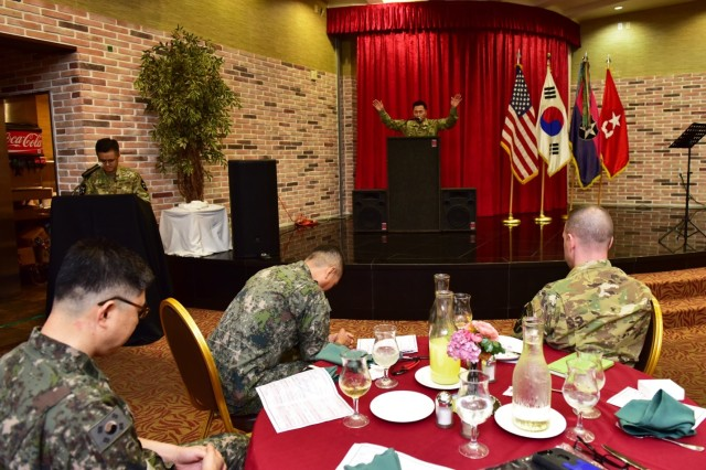 CAMP RED CLOUD, Republic of Korea -- Guest speaker Chaplain (Col.) Chul W. Kim, Eighth Army command chaplain, addresses 2nd Infantry Division/ROK-U.S. Combined Division Soldiers about the significance of spirituality during the 2018 Victory Prayer Luncheon at Mitchell's Grill August 13. The 2ID/RUCD Unit Ministry Team hosted the event in observance of Korean Liberation Day and Victory in the Pacific Day.