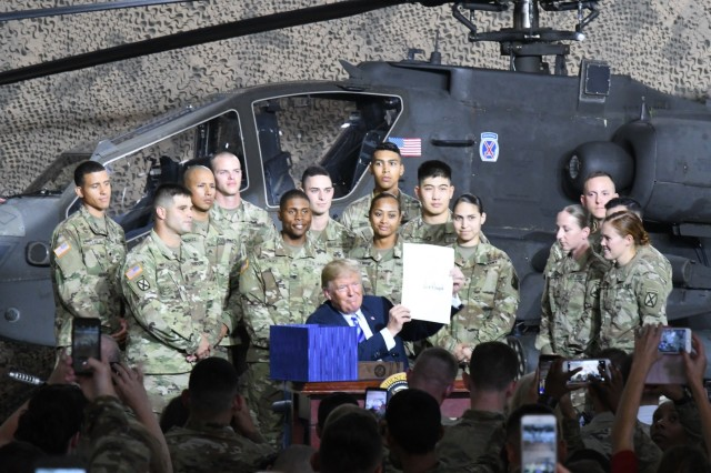 Members of the U.S. Armed Forces can expect a significant bump in their salaries - the largest in nearly a decade - after President Donald Trump signed the 2019 National Defense Authorization Act during a visit to Fort Drum, New York, on Aug. 13.