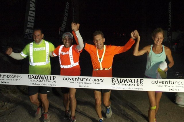 Steven Carr, AMRDEC employee, crosses the finish line at the Badwater 135 ultramarathon with his wife, Stephanie, and two volunteer pacers Matt Humes and Andy Bussell.