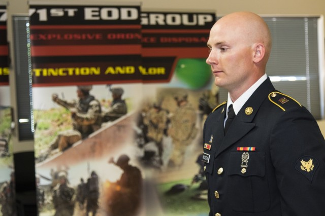 Spc. Michael McClean, an all source intelligence analyst with 71st Ordnance Group (EOD), stands at attention while executing drill and ceremony commands from 242nd Ordnance Battalion Command Sergeant Major, Weston West, during the 71st EOD Soldier/Noncommissioned Officer of the Year competition, May 17, 2018, at the Group's Headquarters.