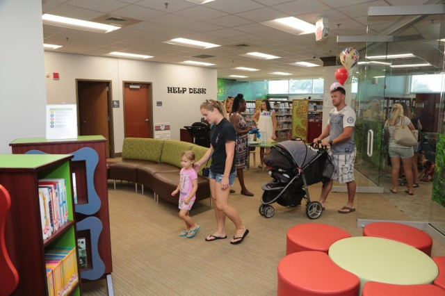 FORT BENNING, Ga. (Aug. 14, 2018) - The Directorate of Family and Morale, Welfare and Recreation at U.S. Army Garrison Fort Benning, Georgia, hosted an open house to celebrate the grand opening of Milton E. Long Library Aug. 14. The library, in Bldg. 2783, 6529 Eckel Ave., opens with more than $4 million in renovation of the 25,000-square foot Long Hall. This event includes refreshments and activities for Fort Benning Families. (U.S. Army photo by Markeith Horace, Maneuver Center of Excellence, Fort Benning Public Affairs)