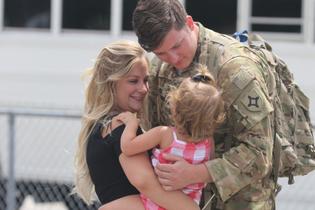 Spc. Alexander Rowland greets his wife and daughter at Jacksonville International Airport near Jacksonville, Florida, on April 29, 2017, after returning from a deployment. The DOD announced on Aug. 13, 2018 that eligibility for Military OneSource benefits for service members and their families has been extended from the current 180 days to 365 days after separation or retirement from military service.